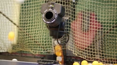Robot for serving of tennis balls turns and shooting balls Stock Footage