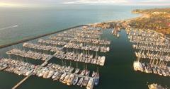 Aerial of sailboat on harbor in Santa Barbara Stock Footage