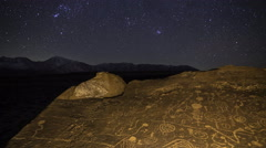 2axis MoCo Astro Time Lapse of Orion over Native American Petroglyphs -Tilt Down - stock footage