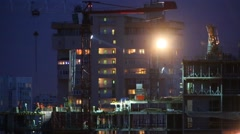 Multi-storey buildings under construction at night Stock Footage
