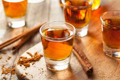 Cinnamon Whiskey Bourbon in a Shot Glass Stock Photos