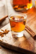 Cinnamon Whiskey Bourbon in a Shot Glass Stock Photos