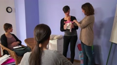 Pregnant Woman Girl Mom Mother Learning Diaper Usage With Newborn Stock Footage