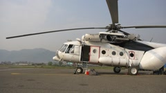 The helicopter is unloaded after landing - stock footage