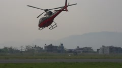 Small helicopter takes off and fly away from the airport Stock Footage