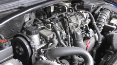 Car engine idling, open hood - stock footage