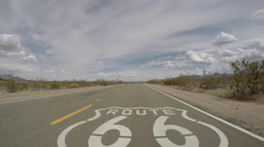 Route 66 California Desert Pavement Sign Driving Shot Stock Footage