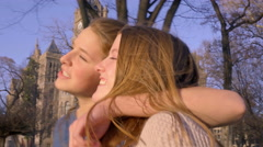 Girl Puts Her Arm Around Her Best Friend And Messes With Her Hair Stock Footage