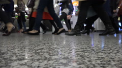 Shoes of commuting metro passengers during rush hour in Shanghai China - stock footage