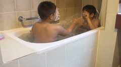 4K, Two Happy asian boy take a bath in bathroom at home Stock Footage