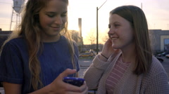 Teen Girl Listens To Song, Shares Her Headphones With Friend, They Sing Along Stock Footage