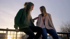 Teens Hang Out Downtown, Sit On Railing, Girl Shows Her Friends Her Nails Stock Footage