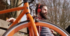 4K Cheerful casual man spending time outdoors in nature & listening to music Stock Footage