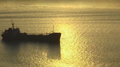 Cargo ship in the light of the reflection of the setting sun. Stock Footage