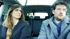 Beautiful woman fighting with boyfriend driving car problems in relationship Stock Footage