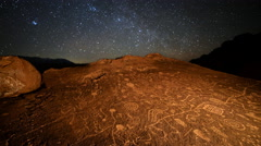 Astro Time Lapse of Star Trails over Native American Petroglyphs -Tilt Up- - stock footage