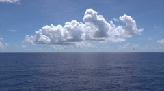 Blue sky, clouds and tranquil water at sea with horizon - stock footage