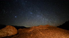 Astro Time Lapse of Star Trails over Native American Petroglyphs -Pan Right- - stock footage