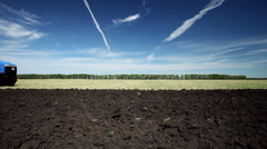Land cultivation. Tractor prepares land for sowing. - stock footage