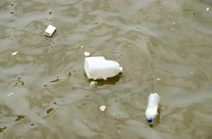 Trash and Garbage in water Stock Photos