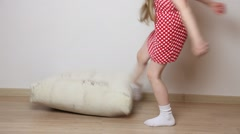 Angry little girl pushing a big pillow Stock Footage