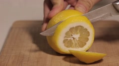 Hand cut with a knife lemon Stock Footage