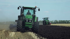 Land cultivation. Tractors prepare land for sowing. Stock Footage
