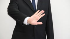 Businessman demonstrating prohibiting of a gesture Stock Footage