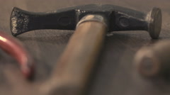 Detail of hammer on a work bench Stock Footage