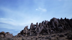 Astrophotography Time Lapse of Stars over Moonlit Rock Formation -Long Shot- - stock footage