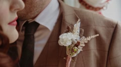 Close-up groom accessory - stock footage