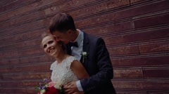 Newlyweds smiling on the street Stock Footage