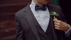 Groom accessory on the street - stock footage