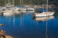 Anchored yachts at Aegean sea harbor Fethiye Turkey Stock Photos