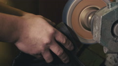 Detail on the hands of Shoemaker reparing sole of leither boots Stock Footage