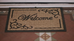 Valentines cards falling on Welcome doormat Stock Footage
