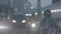 Bikers riding motorbike on street Stock Footage