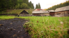 Watermill in a countryside village - stock footage