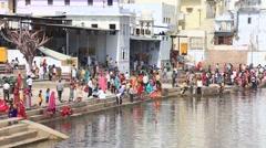 Indian people at ritual washing in sacred Sarovar lake. Pushkar , India Stock Footage