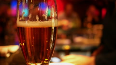 Pint glass of lager on pub - stock footage