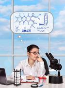 Woman creating new medicament Stock Photos