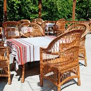 furniture made of willow twigs on the outdoor terrace restaurant - stock photo