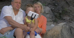 Grandparents and grandchild making funny mobile selfie Stock Footage