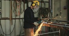 A worker Grinding Metal In a Welding Shop Stock Footage