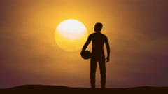 The man stand with a ball against the background of sunset. Time lapse - stock footage