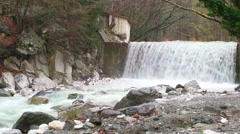 Artificial waterfall on the river  Termopotamos. 4K Stock Footage