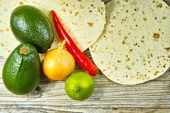 Vegetables set for mexican avocado sauce guacamole - stock photo