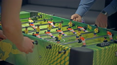 Table soccer. People playing table football Stock Footage