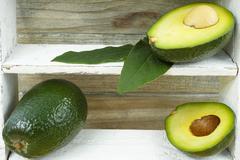Fresh green avocado - stock photo