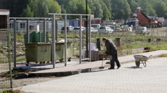Russia, St. Petersburg, janitor cleans out clutter near the - stock footage